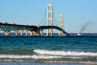 Ship passing under the Mackinac Bridge )